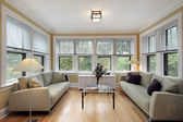 Family room with wall of windows — Stock Photo