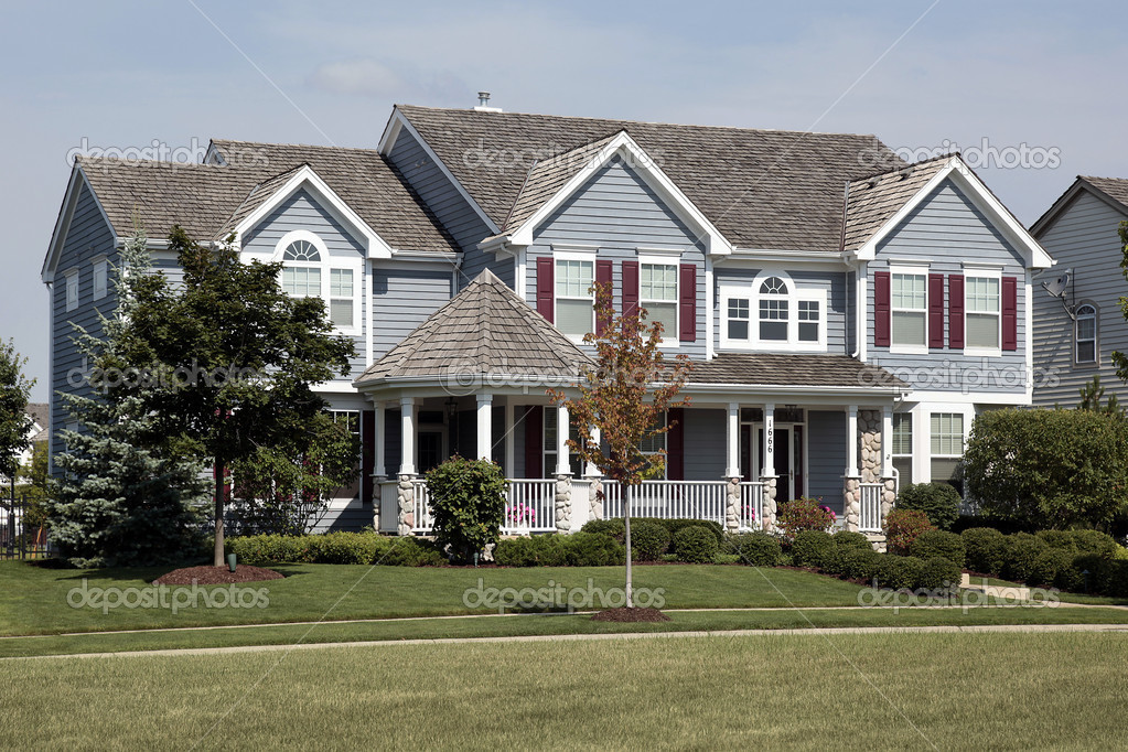 Large home with red shutters and cedar roof  Stock Photo #8657039