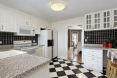 Kitchen with checkerboard floor — Stock Photo