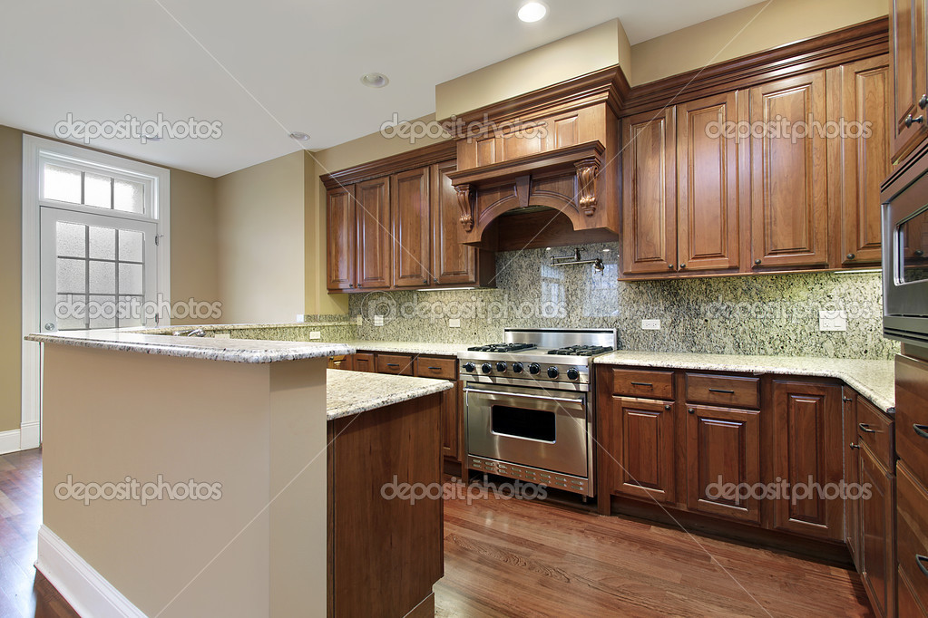 Kitchen in new construction townhouse with wood cabinetry — Stock Photo #8669688