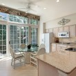 Kitchen with sliding doors to patio — Stock Photo #8670232