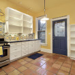 Kitchen with terra cotta floor tile — Stock Photo