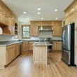 Kitchen with oak wood cabinetry — Stockfoto