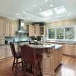 Stock Photo: Luxury kitchen with oak wood cabinetry
