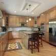 Kitchen with wood cabinetry — Stockfoto