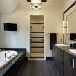 Master bath with dark wood cabinetry — Stock Photo