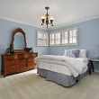 Master bedroom with light blue walls — Stock Photo #8679212