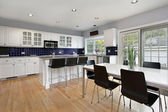 Kitchen with blue tile backsplash — Stock Photo