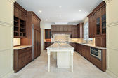 Kitchen with granite island — Stock Photo