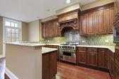 Kitchen with granite backsplash — Stock Photo