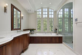 Master bath with wood cabinetry — Stock Photo