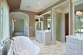 Master bath with standalone tub — ストック写真