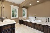 Master bath with dark wood trim — Stock Photo