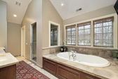 Master bath with wood paneled tub — Стоковое фото