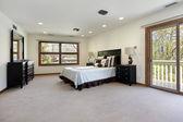 Master bedroom with door to balcony — Stock Photo