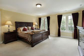 Master bedroom with mahogany furniture — Stok fotoğraf