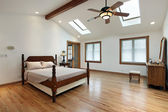 Master bedroom with skylights — Stock Photo