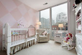 Baby's room with city view — Stock Photo
