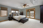 Master bedroom with outside deck — Stock Photo