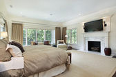 Master bedroom with marble fireplace — Stock Photo