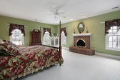 Master bedroom with brick fireplace — Stock Photo