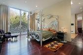 Master bedroom with sliding doors to patio — Stock Photo
