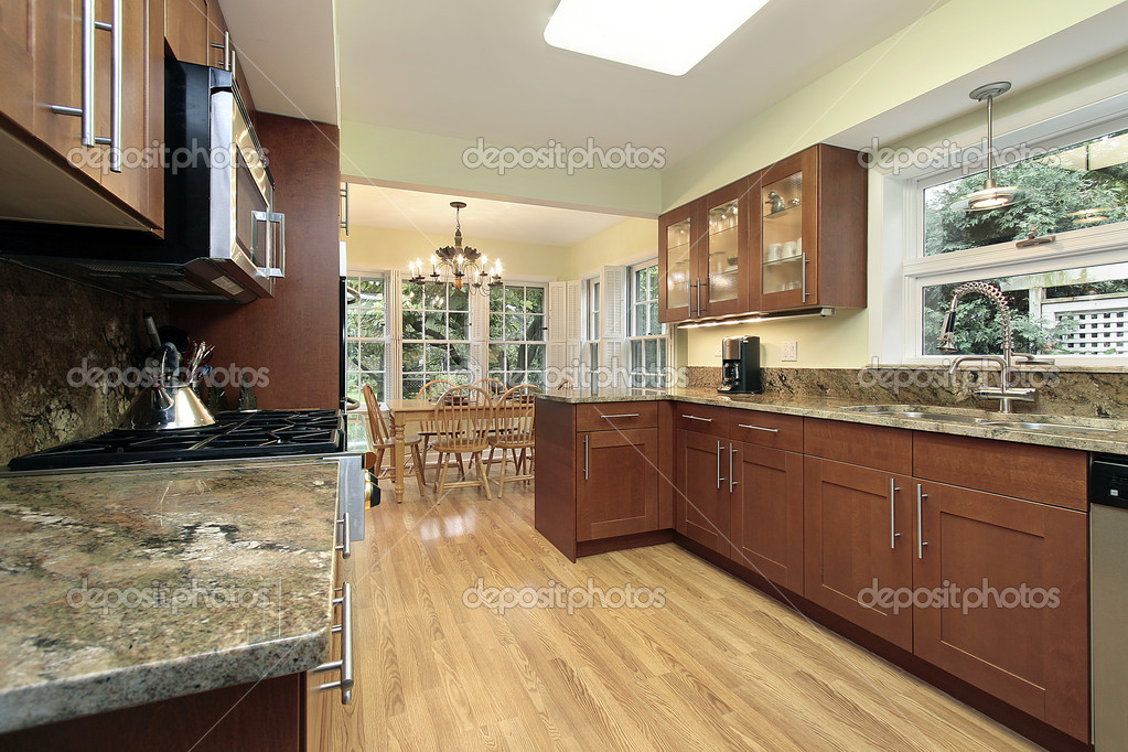 Kitchen in suburban home with windowed eating area  Stock Photo #8670187