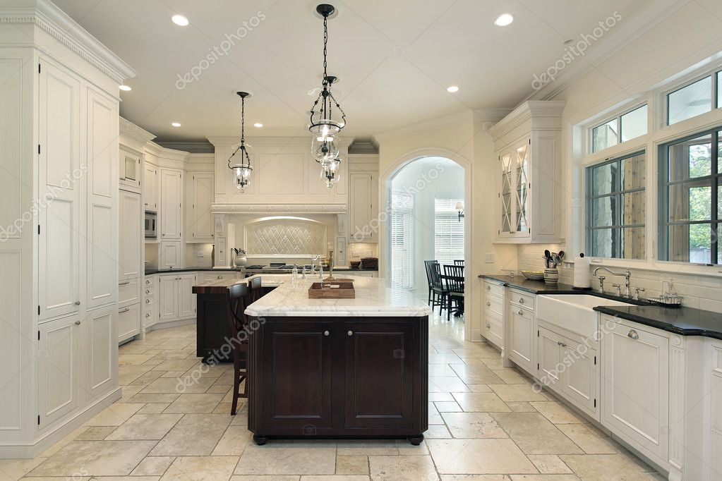 Luxury kitchen in suburban home with white cabinetry — Stock Photo #8670666
