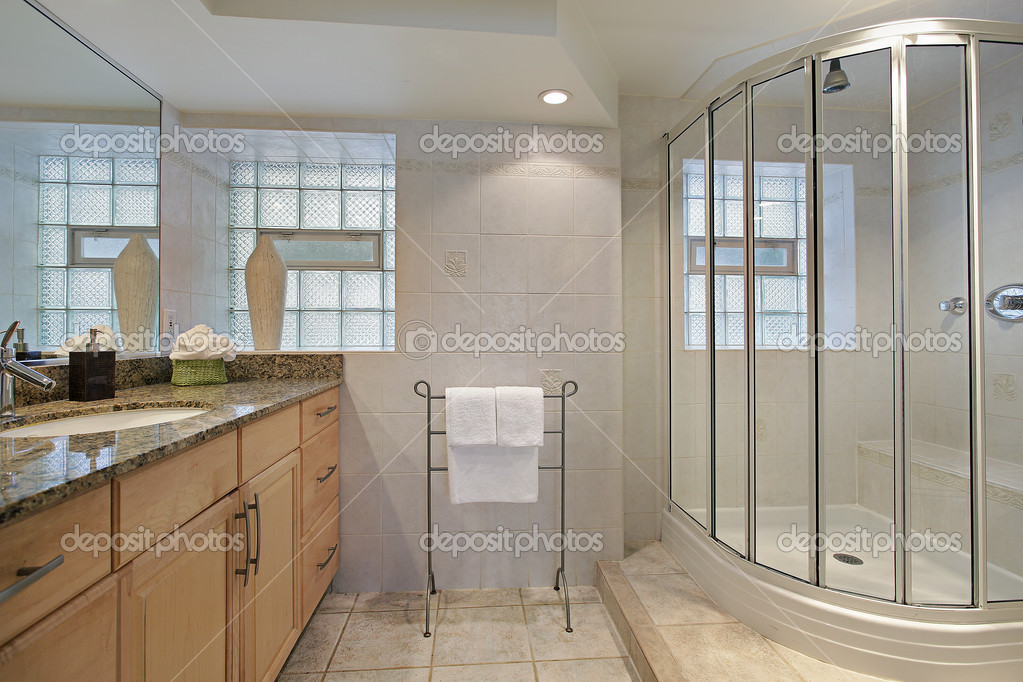 Bathroom in luxury home with glass shower  Stock Photo #8677630
