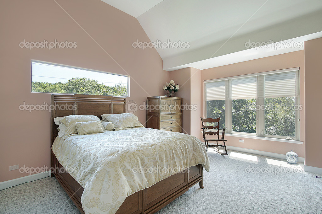 master bedroom with mauve colored walls stock photo