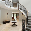 Stock Photo: Foyer with circular staircase