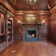 Elegant library with black fireplace — Stock Photo