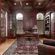 Library with cherry wood paneling — Stockfoto