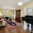 Living room with large piano — Stock Photo #8682427