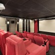 Home theater with red chairs — Stok fotoğraf #8688786
