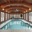 Swimming pool with wood ceiling beams - Stock Photo