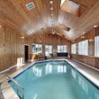 Swimming with wood paneled ceiling - Stock Photo