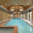 Indoor swimming pool with wood siding - Stock Photo