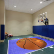 Indoor basketball court in home — Stock Photo