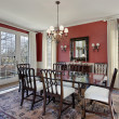 Dining room with red walls - Stockfoto