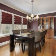 Dining room with maroon walls - Photo