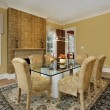Stock Photo: Dining room with gold walls