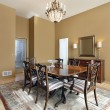 Dining room with tan walls - Lizenzfreies Foto
