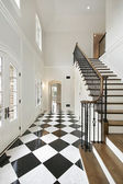 Foyer with checkerboard floor — Stock Photo