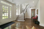 Foyer with staircase and design on floor — Stock Photo