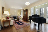 Living room with large piano — Stock Photo