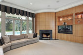 Living room with rounded fireplace — Stock Photo