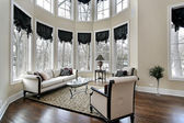 Living room with curved windows — Stock Photo