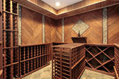 Wine cellar with multiple racks — Stock Photo