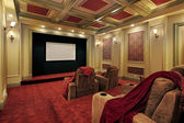 Theater with plush red carpeting — Stock Photo